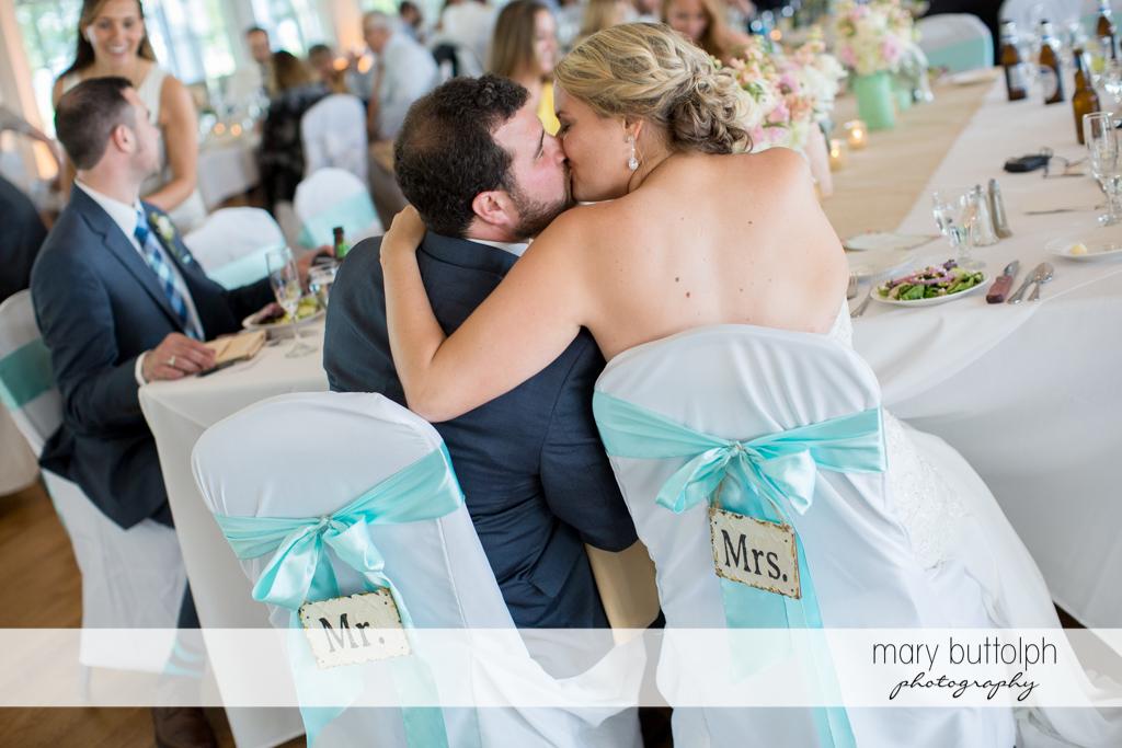 Couple kiss at the wedding venue at Emerson Park Pavilion Wedding