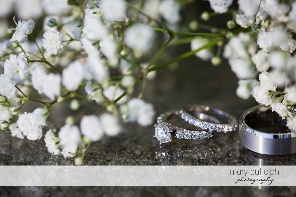 Couple's wedding rings with flowers at Emerson Park Pavilion Wedding