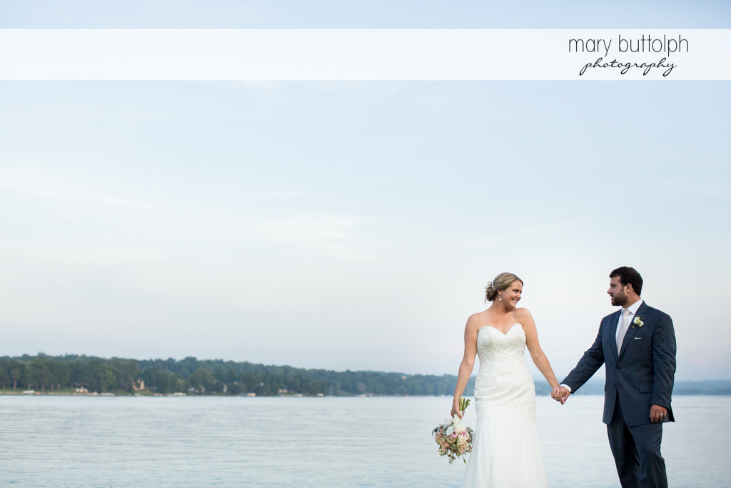 Couple stroll by the lake at Emerson Park Pavilion Wedding