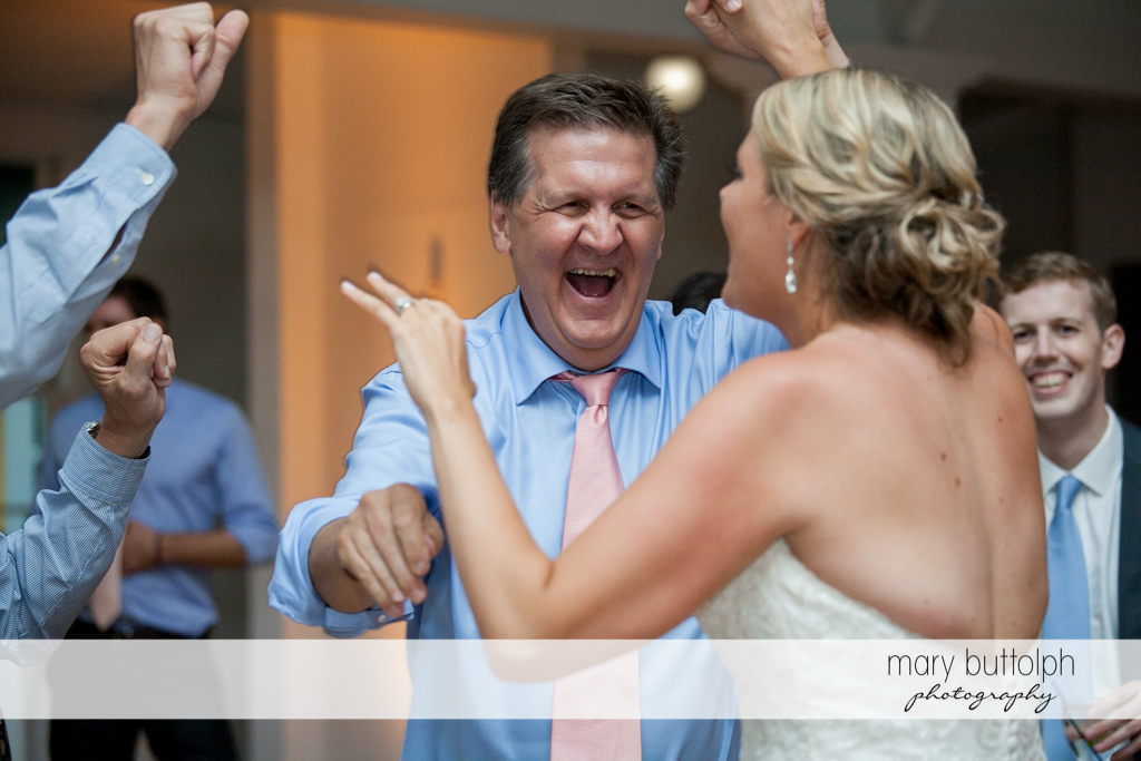 Bride and a guest have fun on the dance floor at Emerson Park Pavilion Wedding
