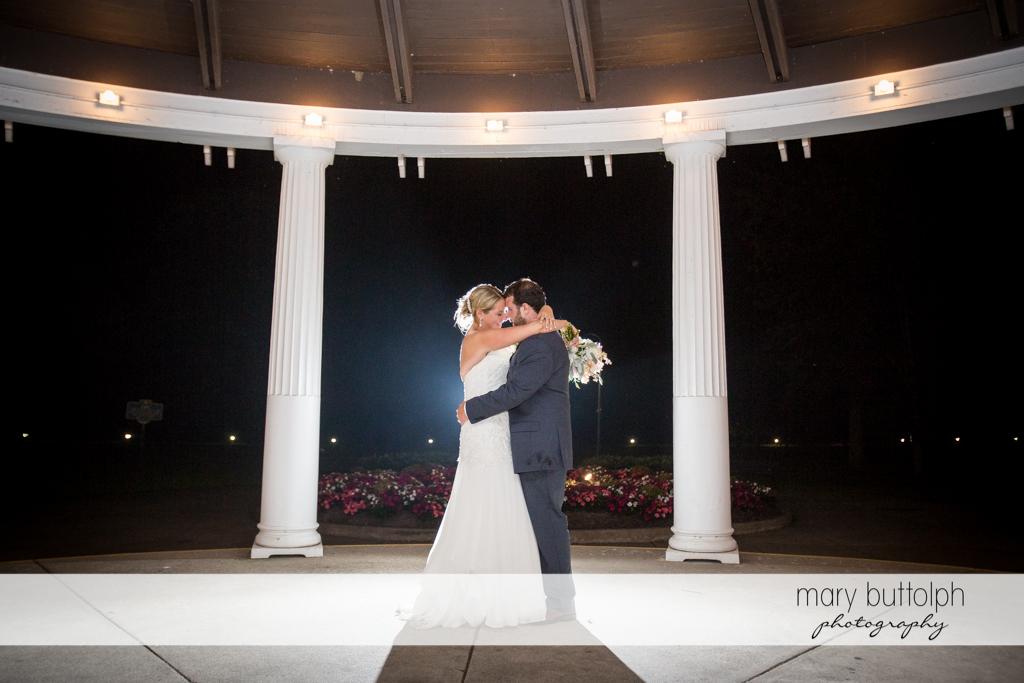 Couple embrace in the pavilion at Emerson Park Pavilion Wedding