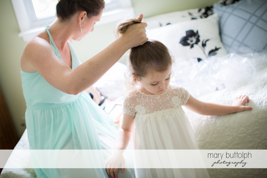 Young girl gets a hair makeover with the help of a friend at Emerson Park Pavilion Wedding