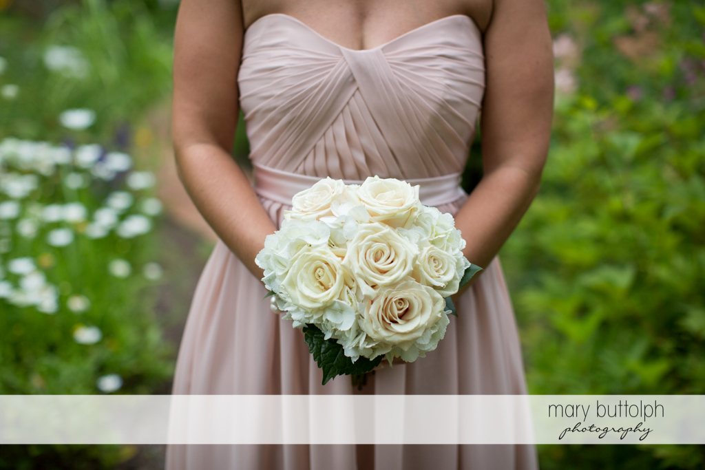 Half body shot of bride with bouquet in the garden at Emerson Park Pavilion Wedding