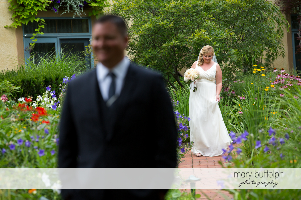 Couple walk in the garden with flowers at Emerson Park Pavilion Wedding