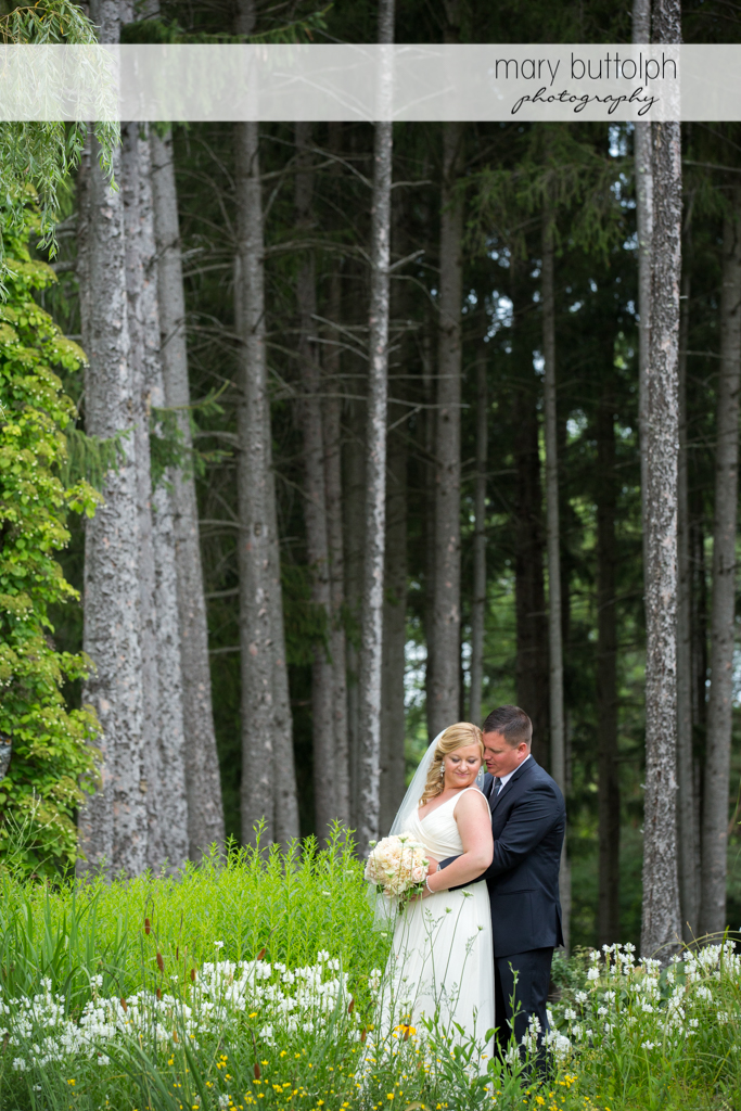 Couple pose in the woods at Emerson Park Pavilion Wedding