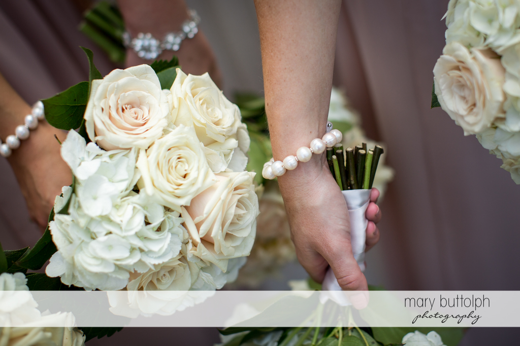 Close up shots of the bridesmaids' bouqeuts and bracelets at Emerson Park Pavilion Wedding