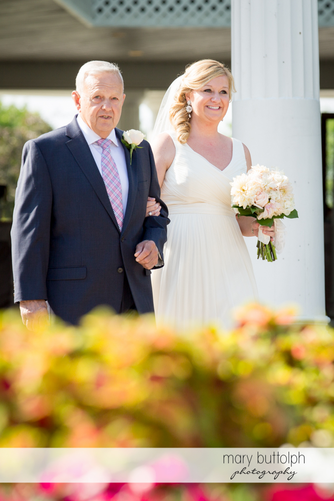 Bride is escorted by her father in the garden at Emerson Park Pavilion Wedding