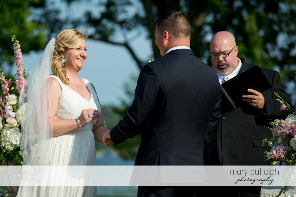 Couple exchange wedding vows in front of the marriage officiant at Emerson Park Pavilion Wedding