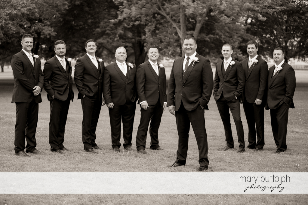 The groom and his groomsmen look classy in the garden at Emerson Park Pavilion Wedding