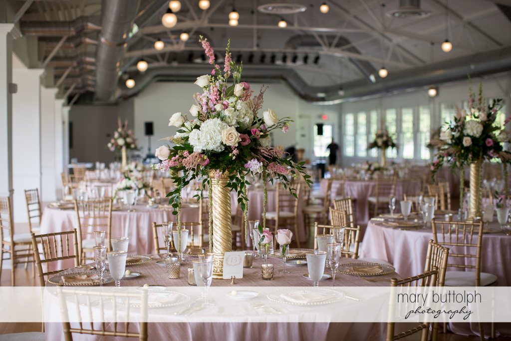 Flowers are found on the tables at the wedding venue at Emerson Park Pavilion Wedding