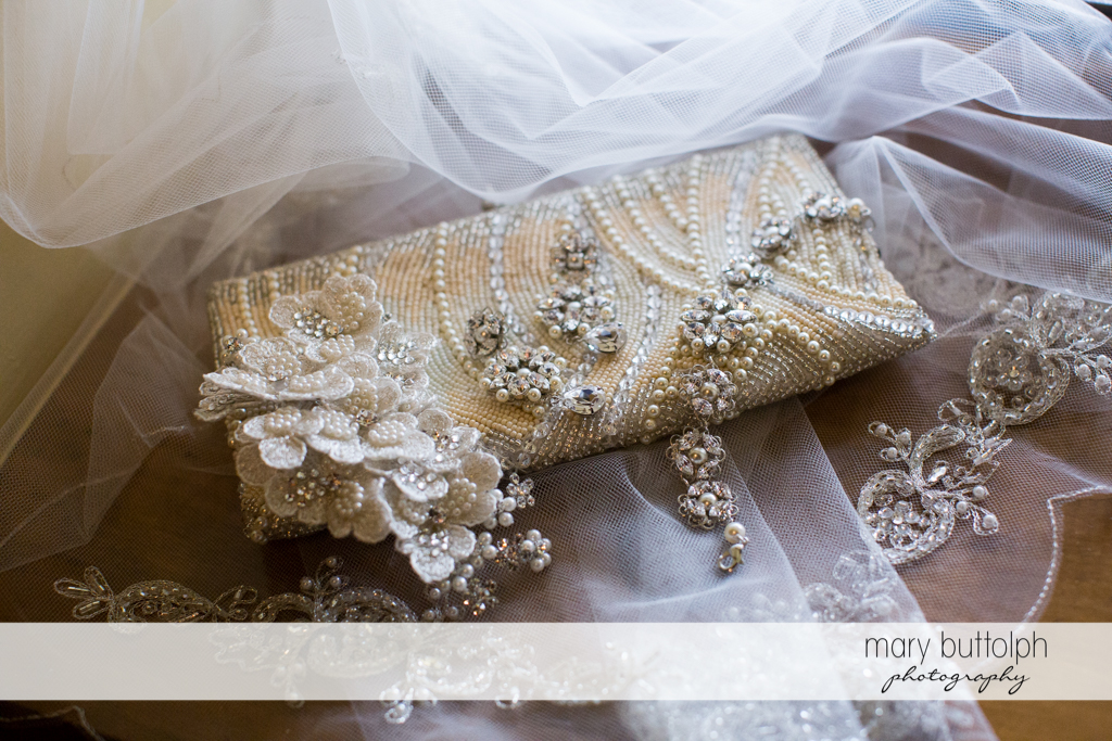 Close up shot of the bride's purse and wedding veil at Emerson Park Pavilion Wedding