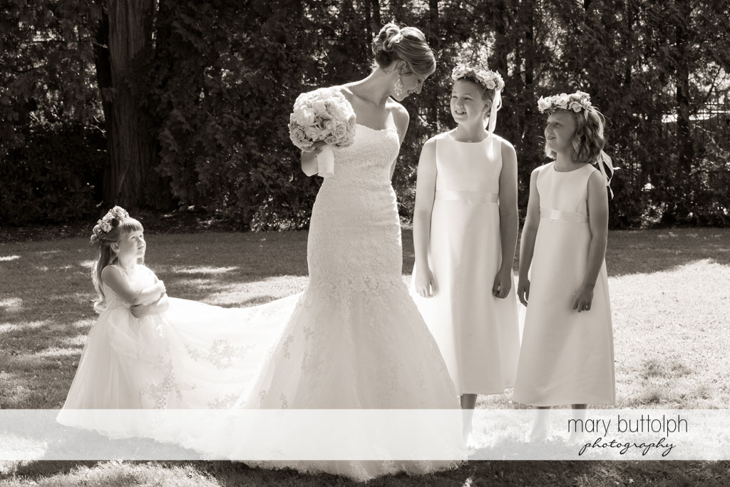 Bride and her flower girls pose in the garden at Skaneateles Country Club Wedding