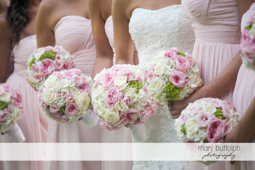 Close up shot of the bridesmaids' bouquets at Skaneateles Country Club Wedding