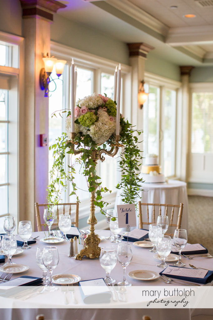Flowers adorn the table at the wedding reception at Skaneateles Country Club Wedding