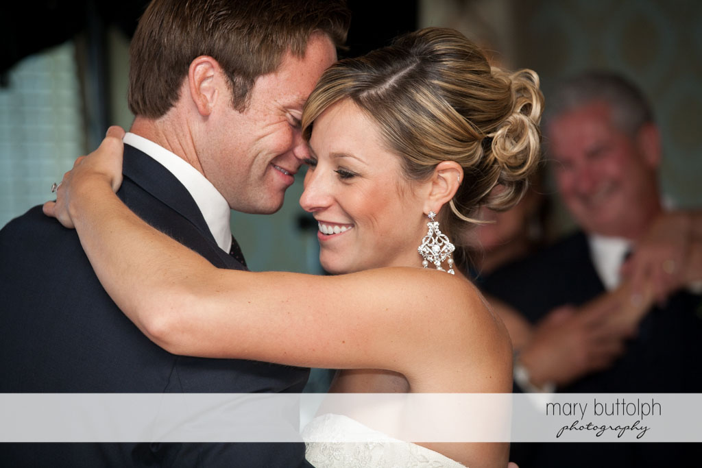 Couple dance in front of guests at Skaneateles Country Club Wedding