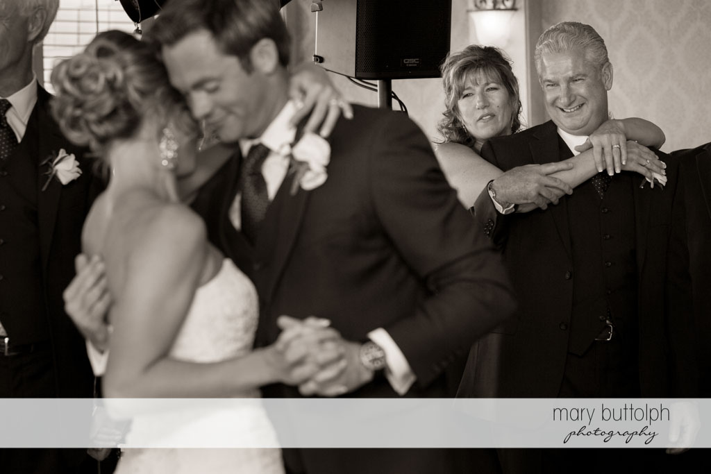 Couple on the dance floor with guests at Skaneateles Country Club Wedding