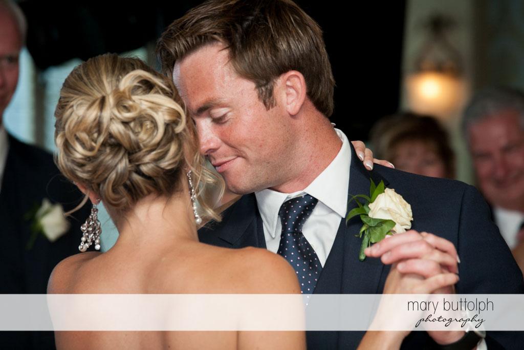 Couple dance cheek to cheek at Skaneateles Country Club Wedding
