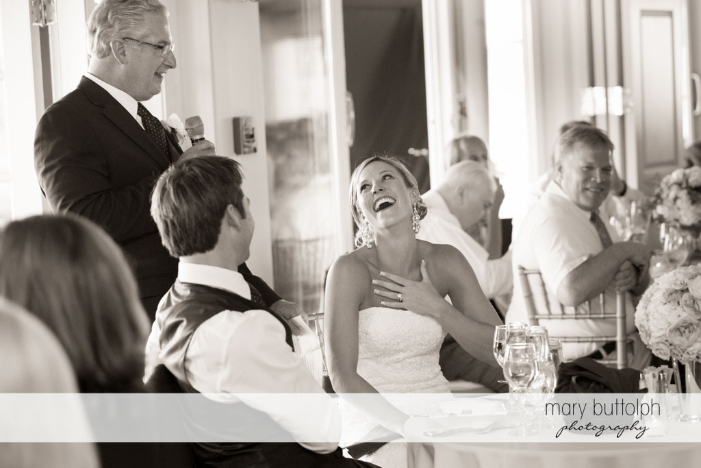 Bride is surprised at what her father says during the wedding reception at Skaneateles Country Club Wedding