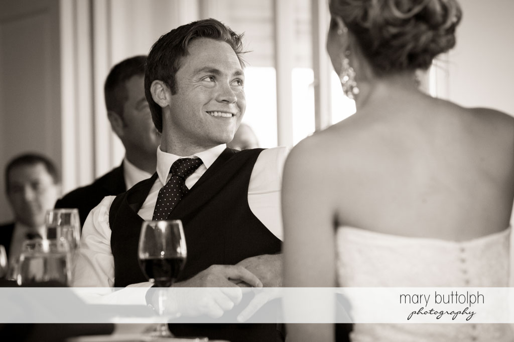 Groom listens to the bride's father at Skaneateles Country Club Wedding