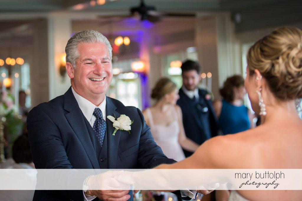 The father of the bride smiles as the two dance at Skaneateles Country Club Wedding