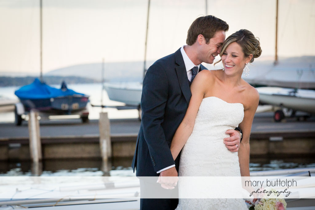 Couple pose on the docks at Skaneateles Country Club Wedding