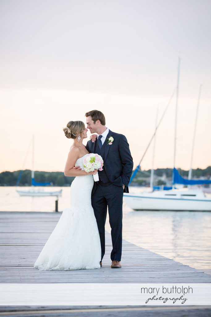 Couple stand near the lake at Skaneateles Country Club Wedding
