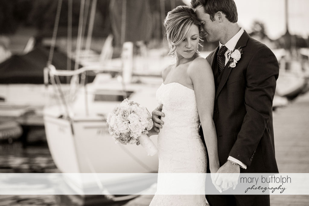 A dramatic black and white shot of the couple on the docks at Skaneateles Country Club Wedding