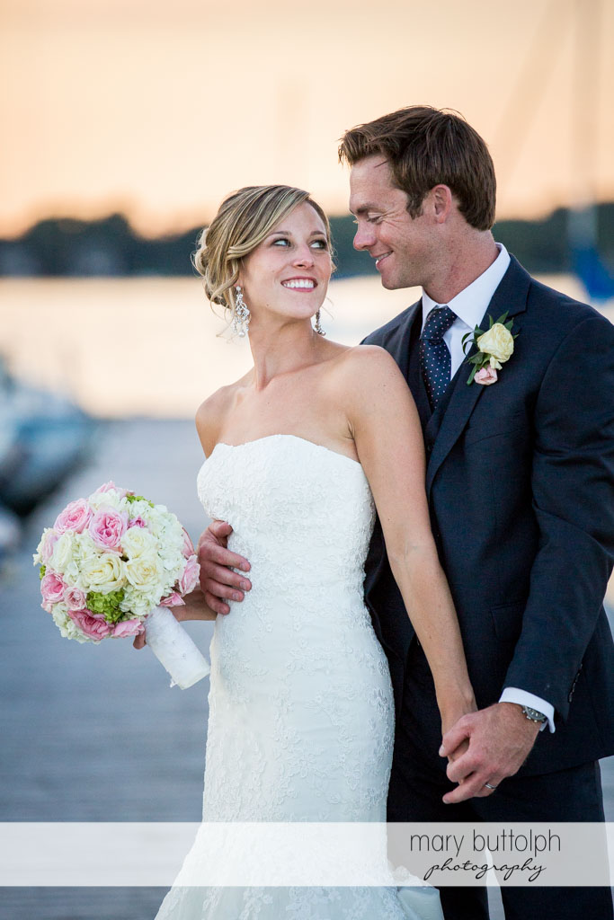 This beautiful shot captures the couple's happiness as they pose by the lake at Skaneateles Country Club Wedding