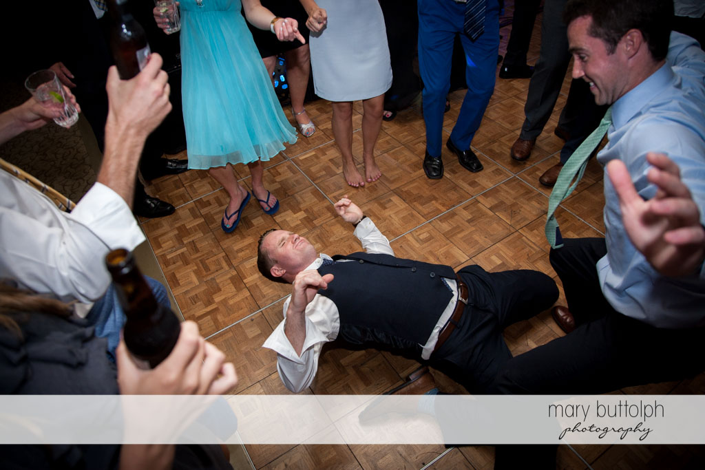 One of the guests shows his dancing skills at Skaneateles Country Club Wedding