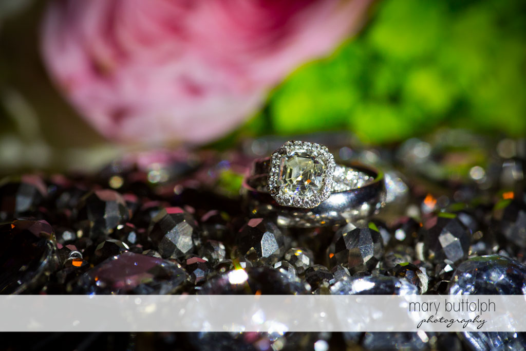 Couple's wedding rings tower above the trinkets at Skaneateles Country Club Wedding