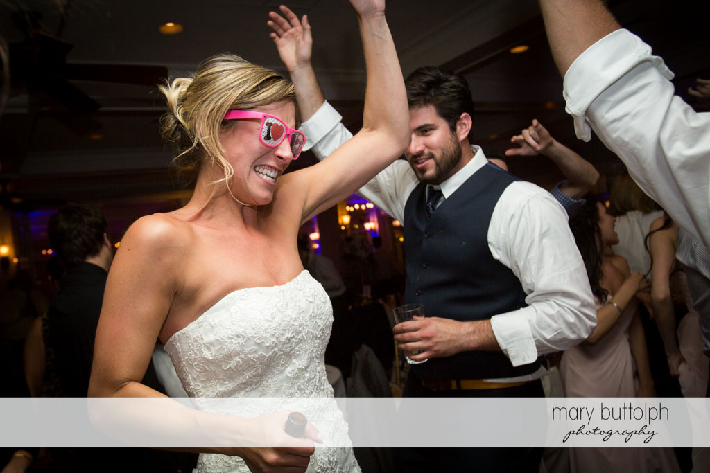 Bride in funny glasses lights up the dance floor at Skaneateles Country Club Wedding