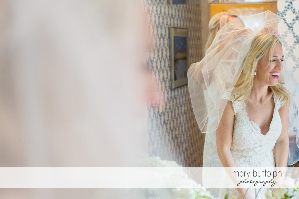 Bride's reflection in the mirror at Skaneateles Country Club Wedding