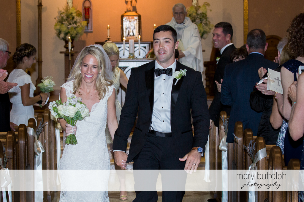 Guest applaud couple as they leave the church at Skaneateles Country Club Wedding