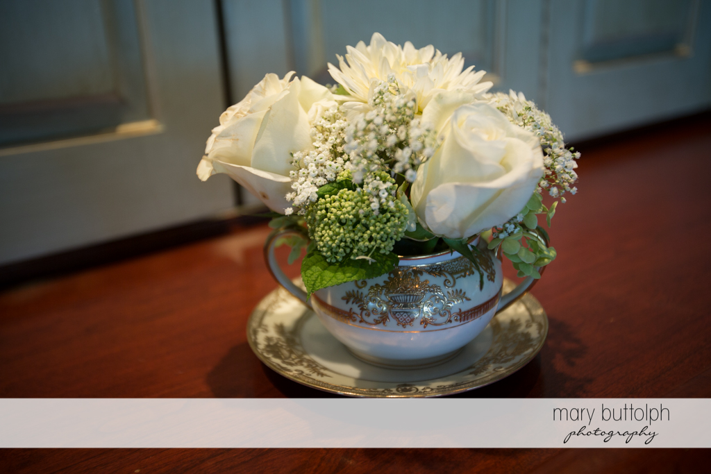 A cup of flowers at the wedding reception at Skaneateles Country Club Wedding