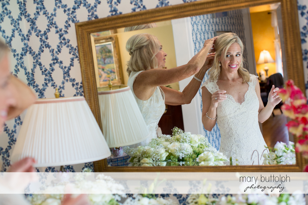 Bride and her mother are seen in the mirror at Skaneateles Country Club Wedding