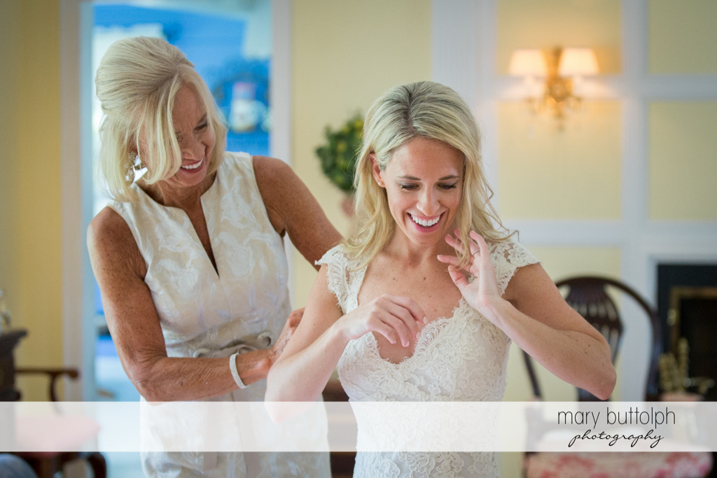 Bride and her mother share a happy moment at Skaneateles Country Club Wedding
