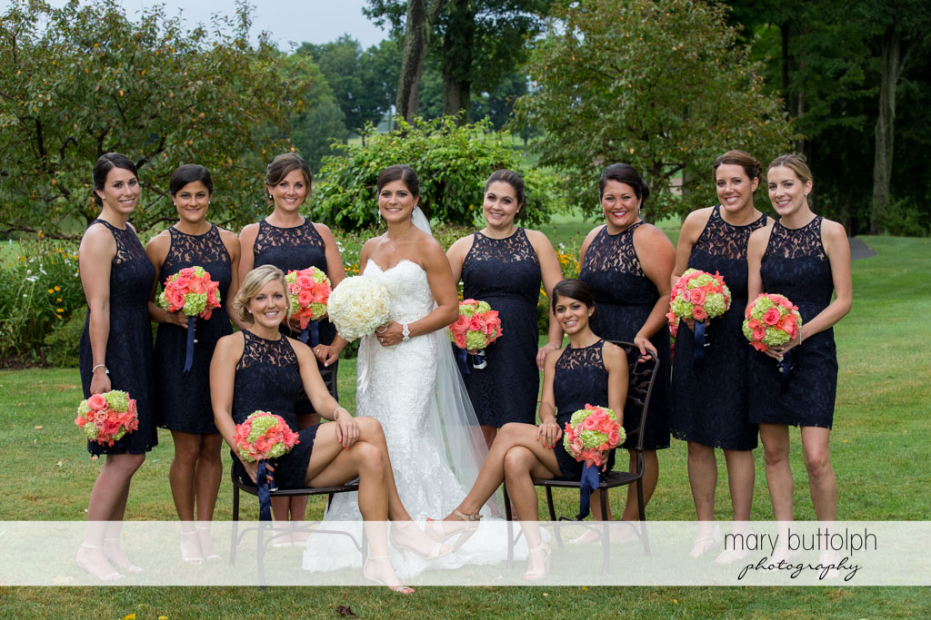 Bride and her bridesmaids in the garden at Turning Stone Resort Casino Wedding