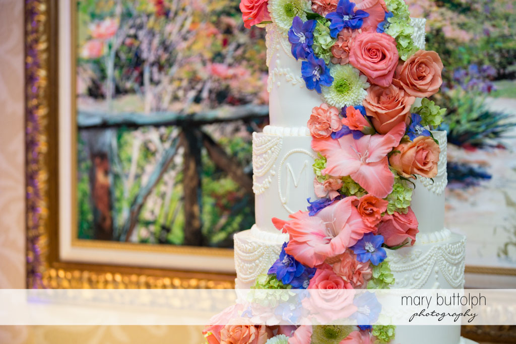 Flowers add beauty to the wedding cake at Turning Stone Resort Casino Wedding
