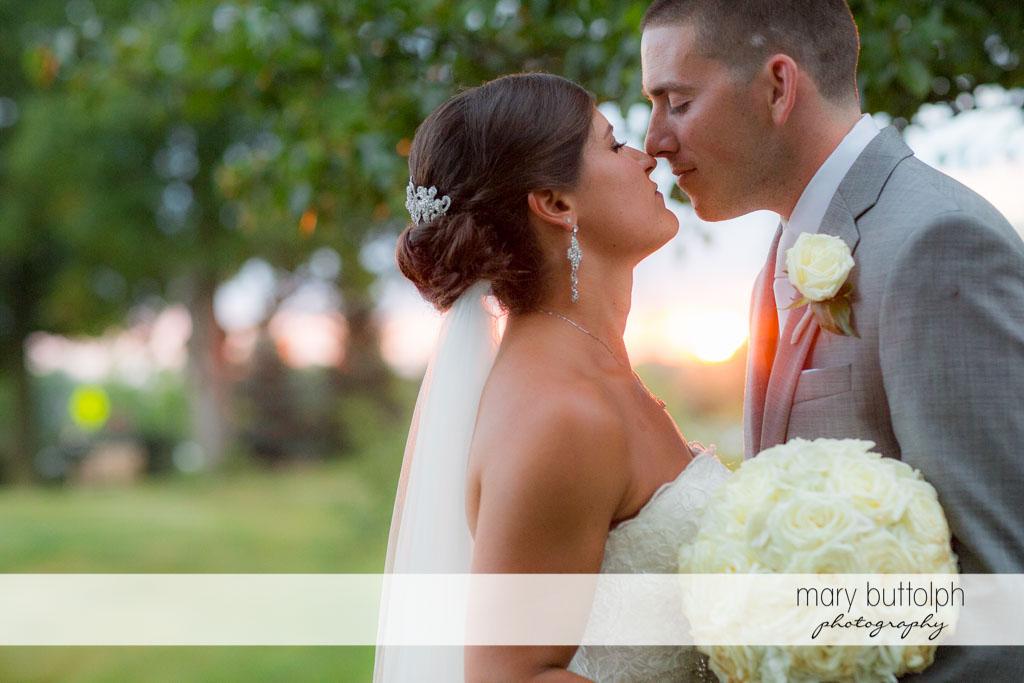 Couple rub noses in the garden at Turning Stone Resort Casino Wedding