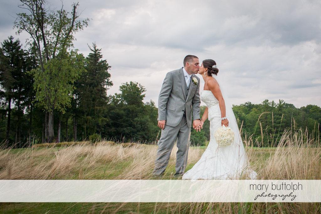Couple get romantic on the field at Turning Stone Resort Casino Wedding