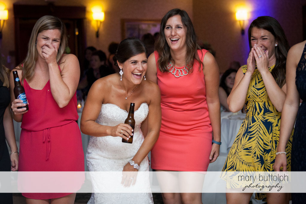 Bride and guests share a laugh at Turning Stone Resort Casino Wedding