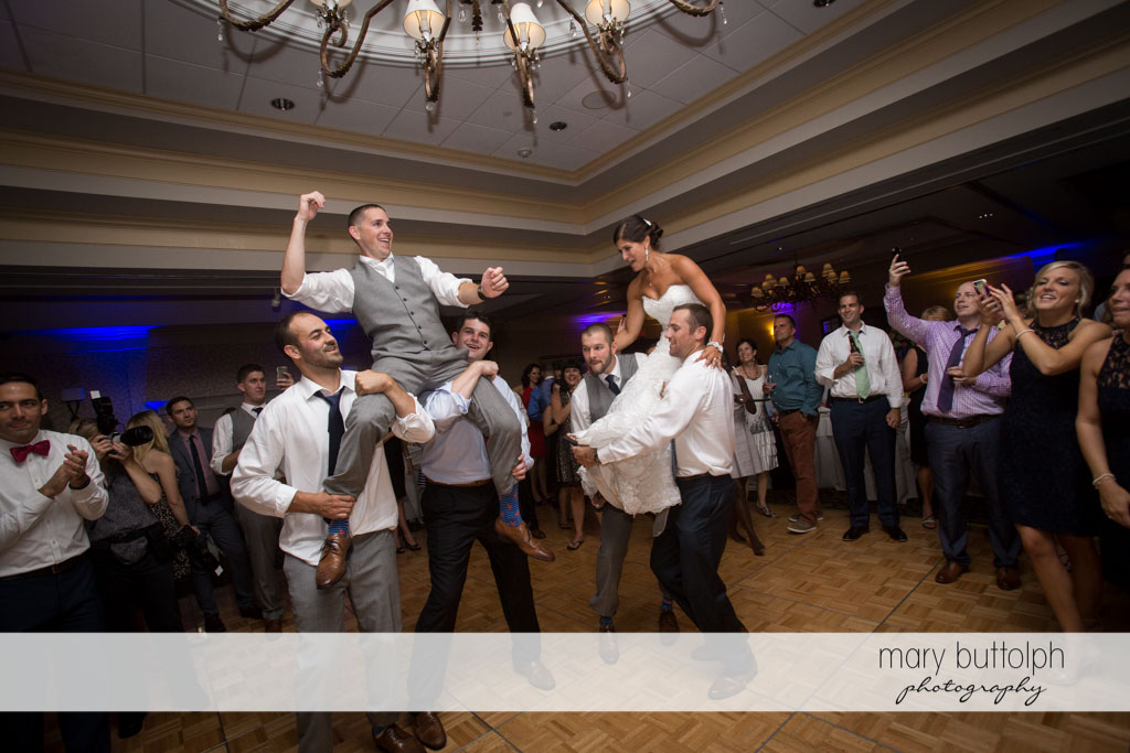 Couple are carried by guests at Turning Stone Resort Casino Wedding