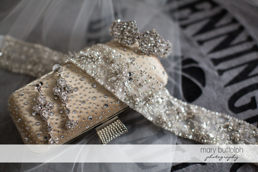 Bride's wallet, earrings, and wedding ring at Turning Stone Resort Casino Wedding