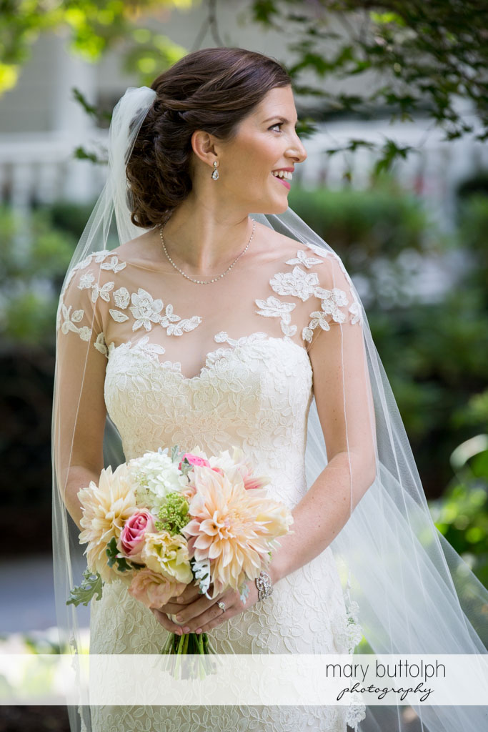 Side view of the pretty bride with bouquet at Skaneateles Country Club Wedding