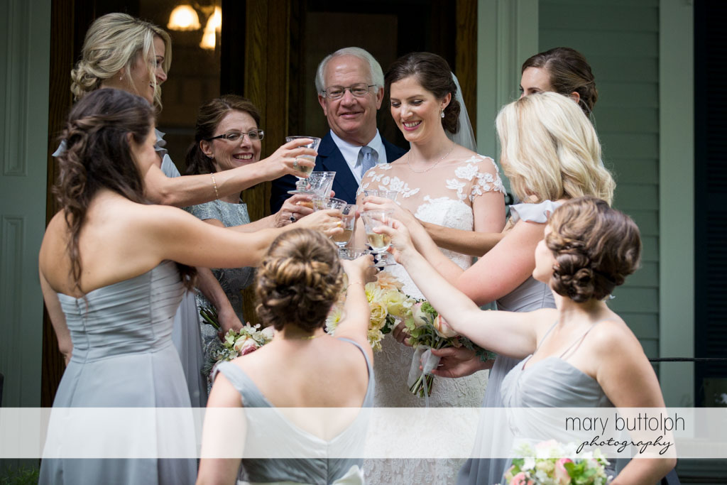 Bride and bridesmaids make a toast before the wedding at Skaneateles Country Club Wedding