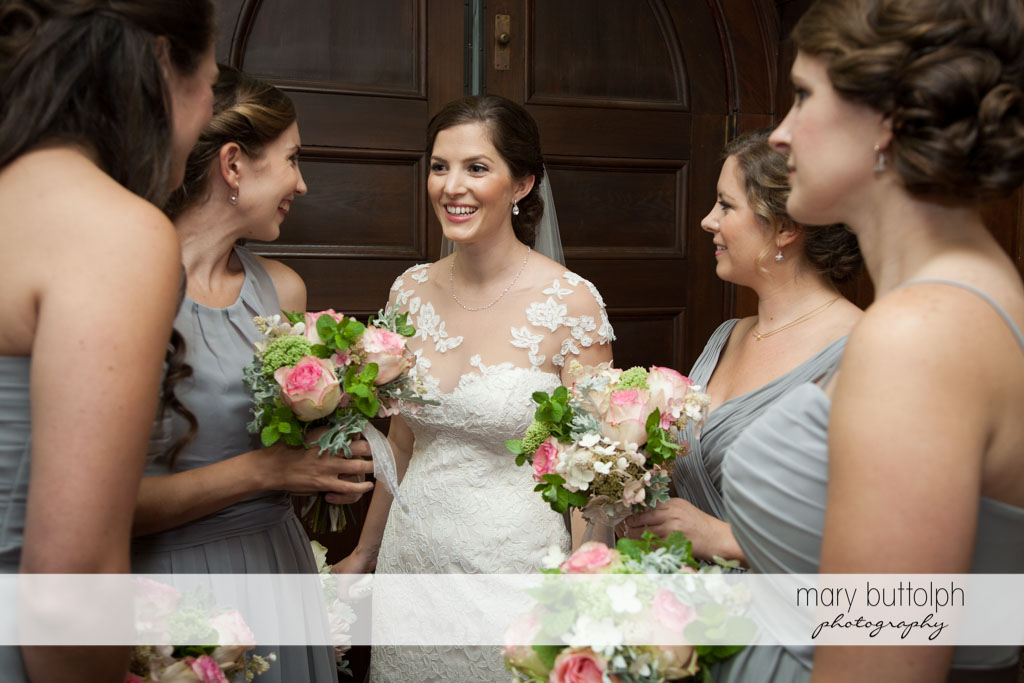 Brides talks to the bridesmaids at Skaneateles Country Club Wedding