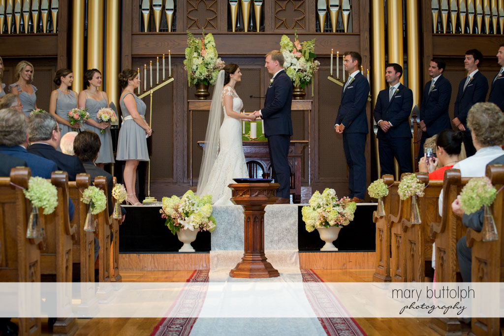 Couple in front of the altar as guests look on at Skaneateles Country Club Wedding