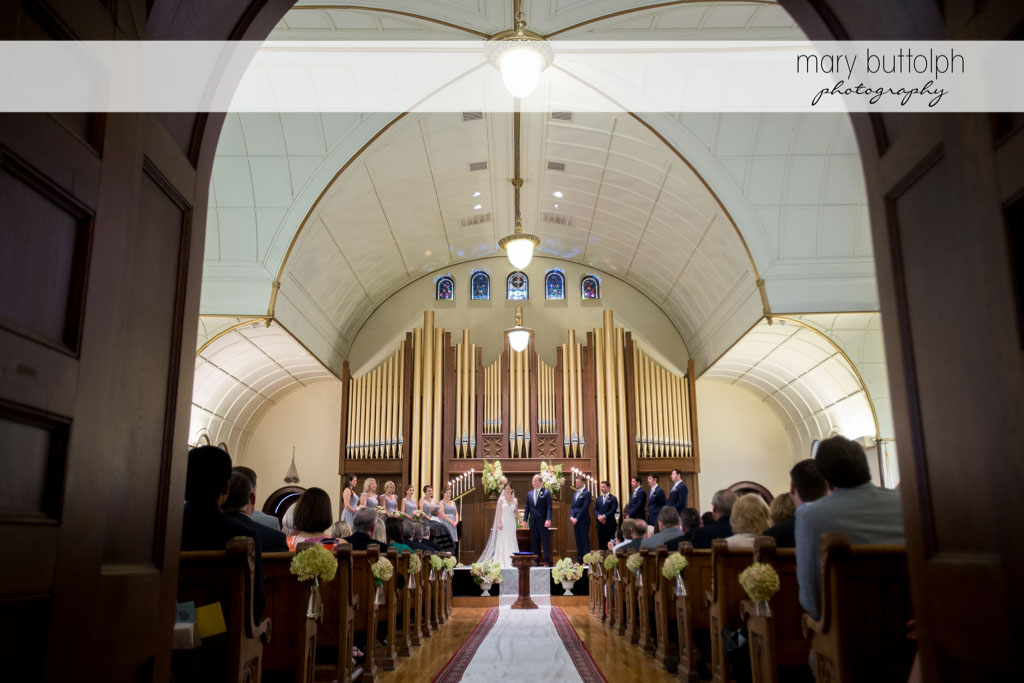 Long shot of the wedding party at the altar at Skaneateles Country Club Wedding