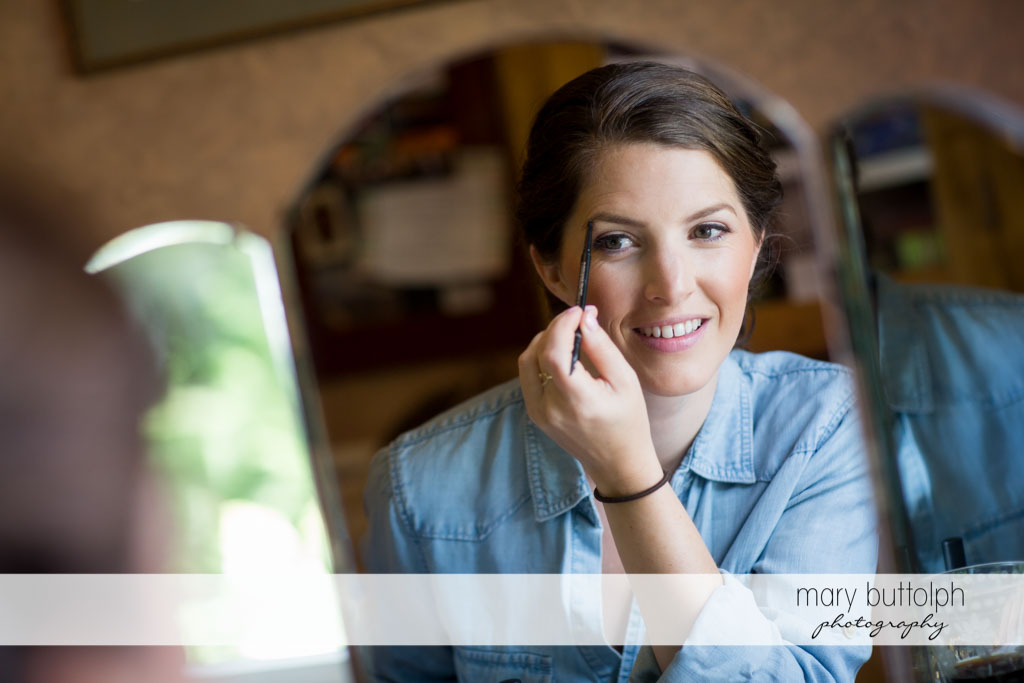 An eyebrow pencil is the bride's best friend at Skaneateles Country Club Wedding