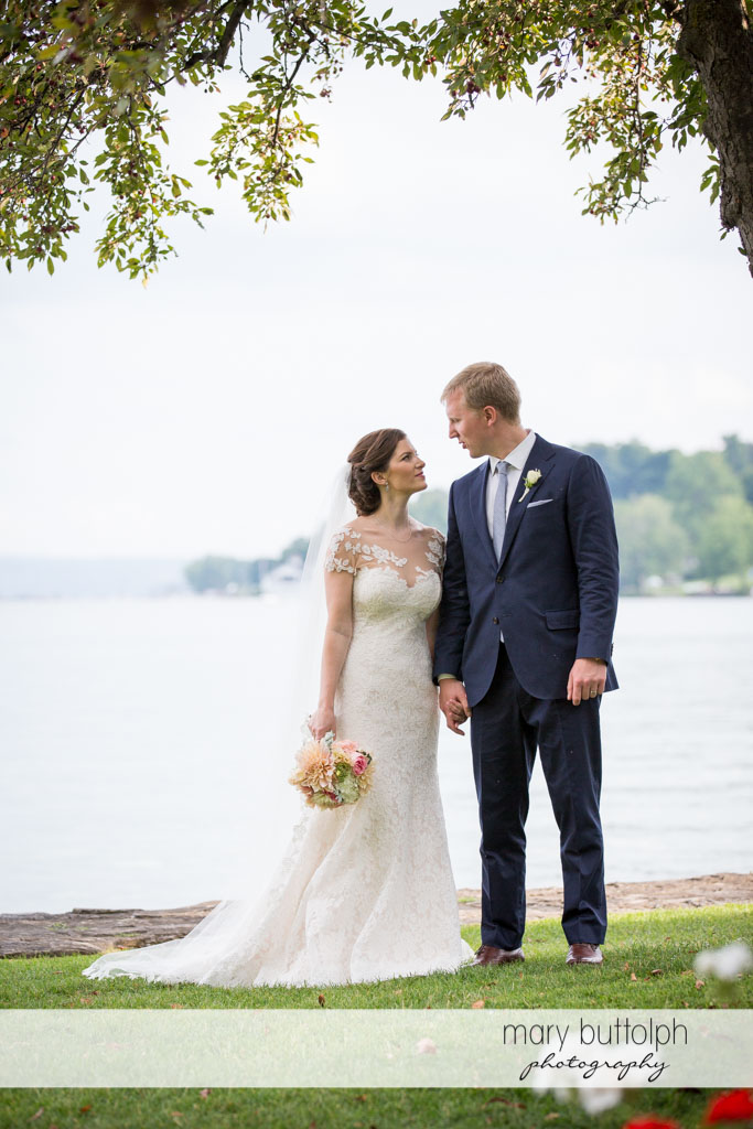 Couple stare at each other by the lake at Skaneateles Country Club Wedding